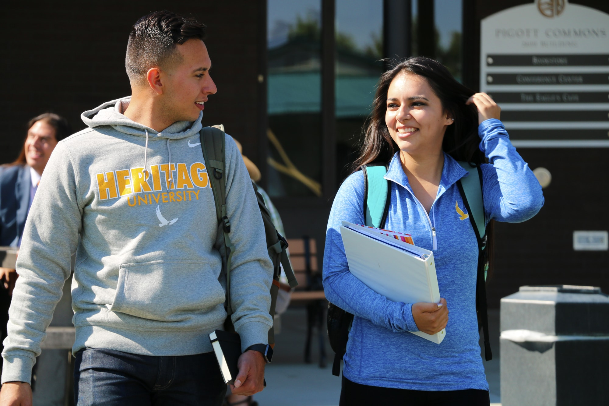 Male and Female Students Walking On Campus