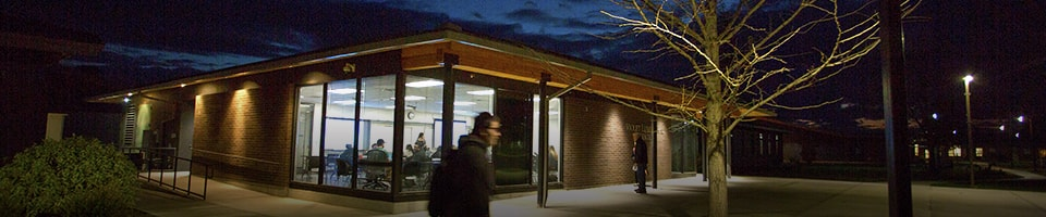 outdoor nigh time image of building at heritage univeristy