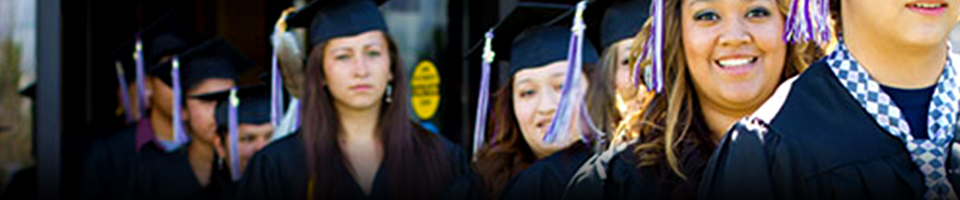 Students smiling walking to graduation ceremony