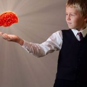 Boy with floating brain in hand