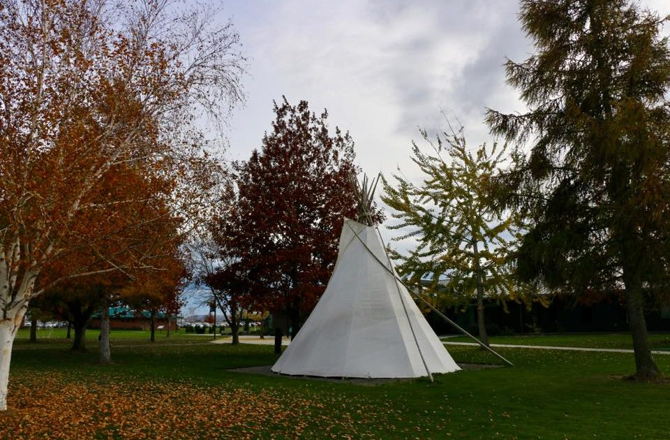 Fall shot of campus with tipi