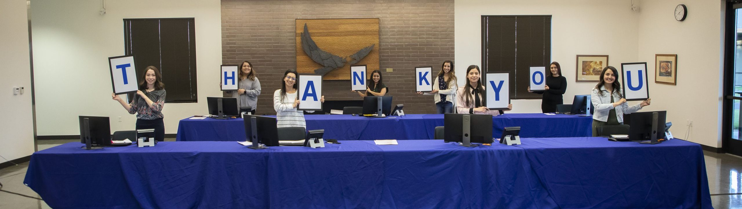 Student phone operators holding Thank You Sign