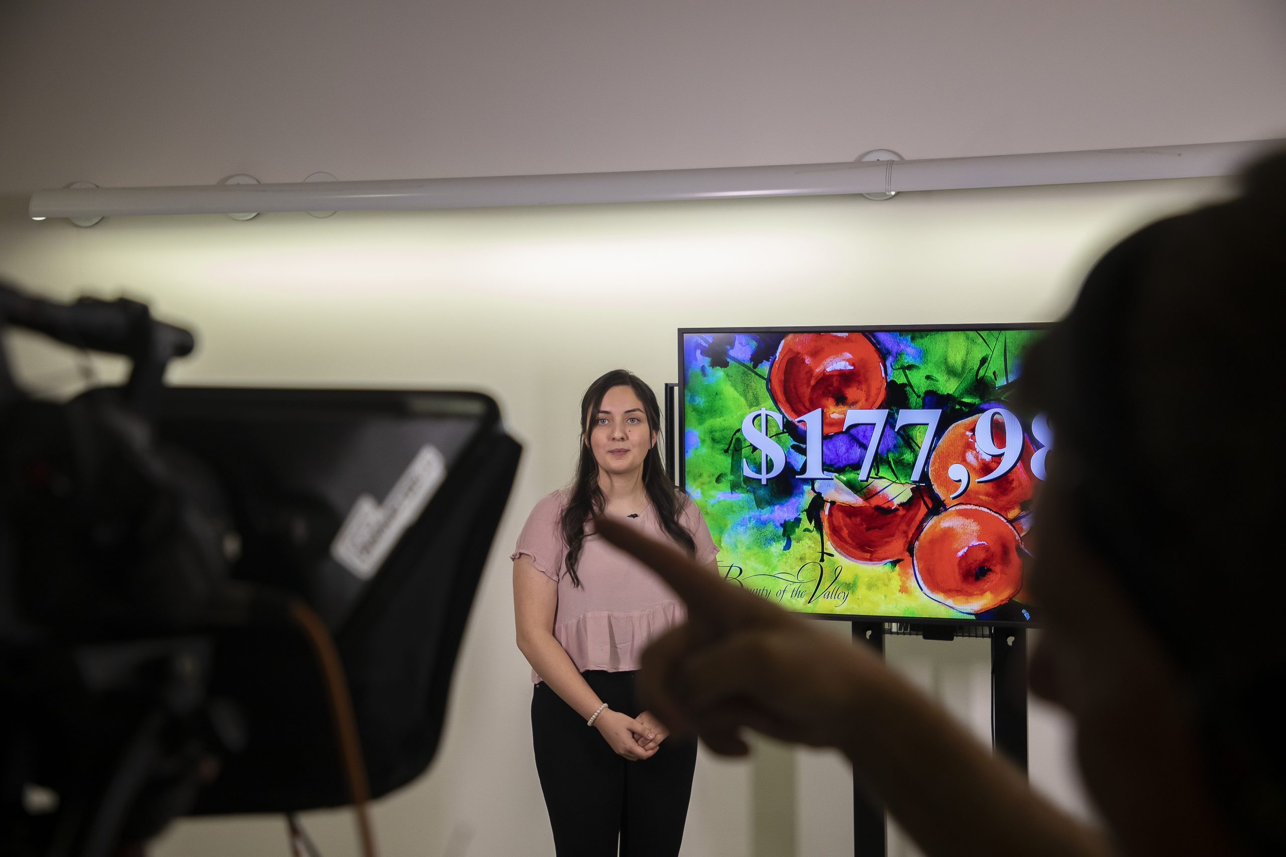Heritage University student Maritza Alvarez receives a camera cue during the Bounty of the Valley Virtual Scholarship Dinner June 5, 2021