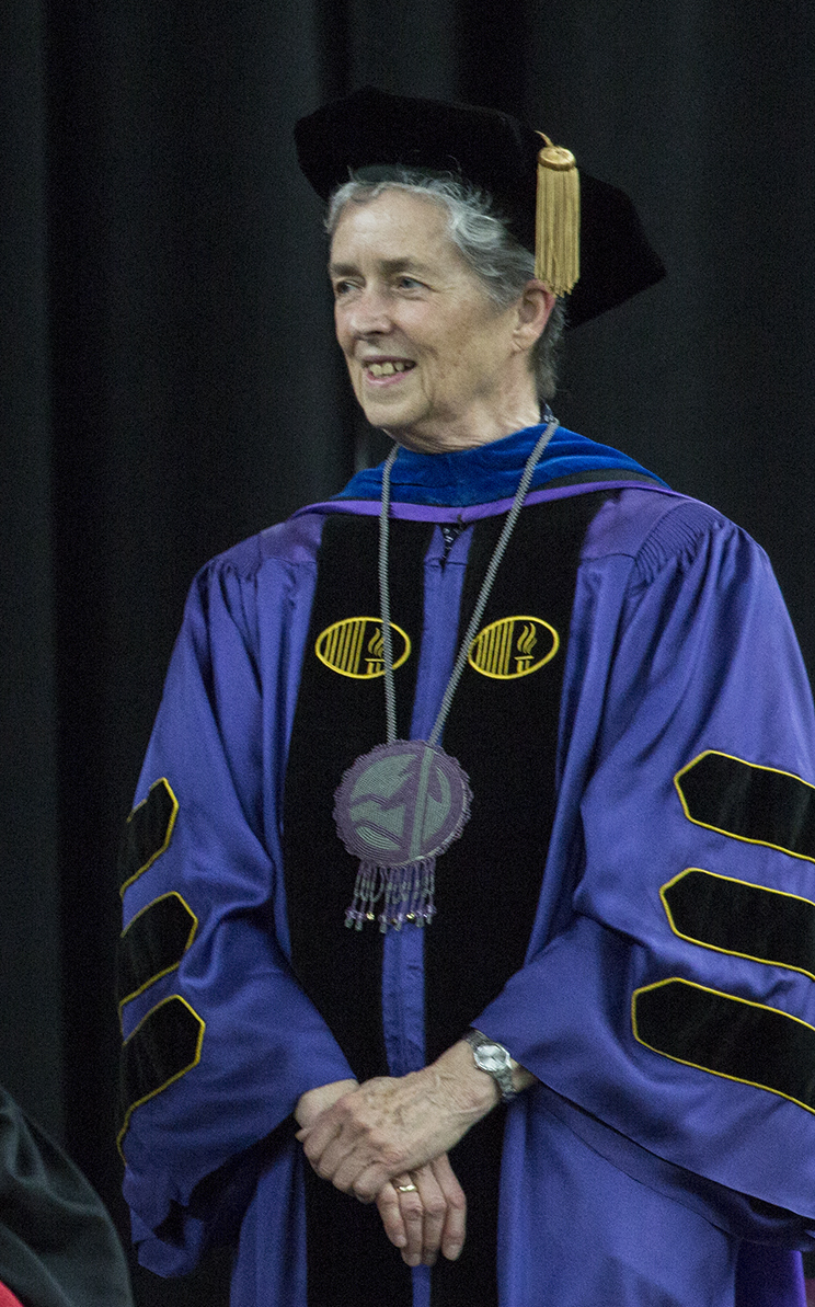 Kathleen Ross, snjm standing onstage at the 36th Annual Heritage University Commencement at the Yakima Valley SunDome