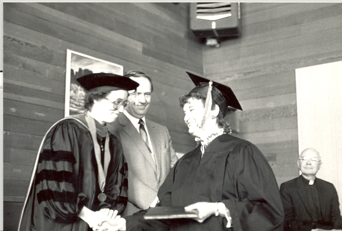 Kathleen Ross, snjm greeting student participating in Heritage College commencement ceremony