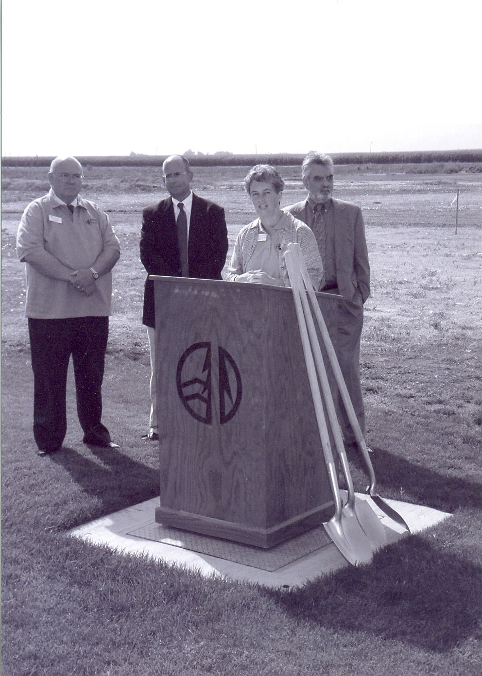 Kathleen Ross, snjm standing at a podium delivering a few words during groundbreaking ceremony at Heritage College